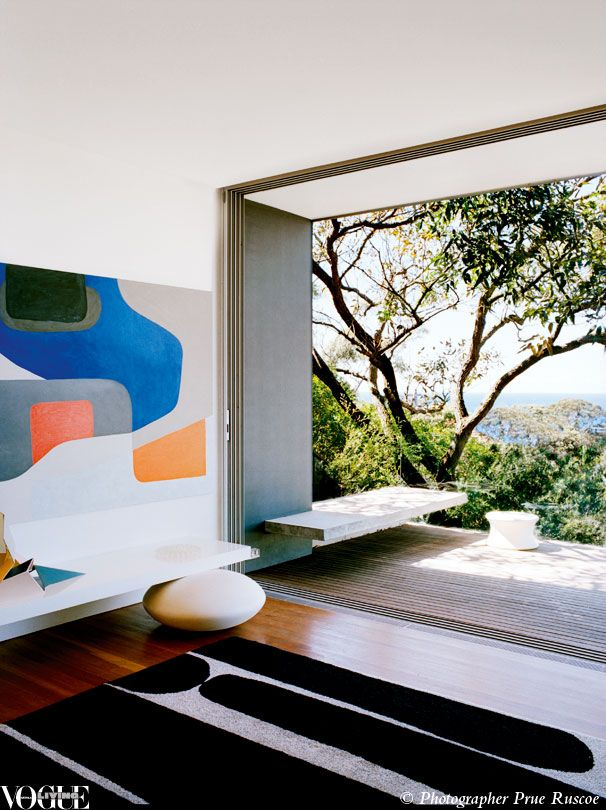 Airy, informal and open to air currents, the living room of Dinosaur Designs founders Louise Olsen and Stephen Ormandy has an enviable view of the ocean. From 'Bright Stars', a story on page 98 of Vogue Living Jan/Feb 2010. Photograph by Prue Ruscoe.