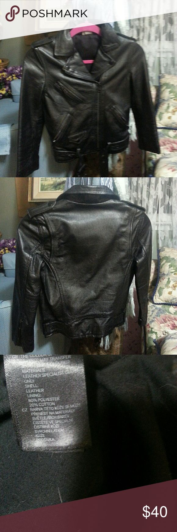 """H&M black leather cropped moto jacket This jacket says size 4 but it is like xxs. This has been re poshed and is worn.. It's tiny. The belt buckle and zippers lost black paint. The measurements are underarm to underarm is 16"""", shoulder to shoulder is 14.5:. The waist is 15"""".  From bottom of collar to the bottom of jacket on the back  of jacket is 18.5:, and the same on the front is 20:.The arm length from shoulder is 18.5"""". Arm width is 7.5"""" from shoulder to underarm.  This jacket is for…"""