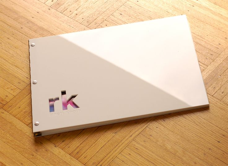 White acrylic screwpost portfolio with custom cut-out and engraving