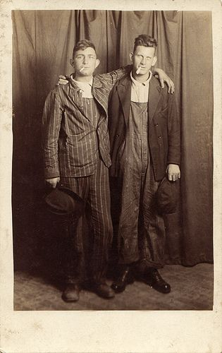 Two men posing with cigarettes, circa 1910