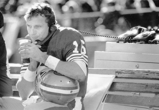 Candlestick Park:  Joe Montana on the phone in the first half of a 49ers game against the Vikings. Jan. 1, 1989.