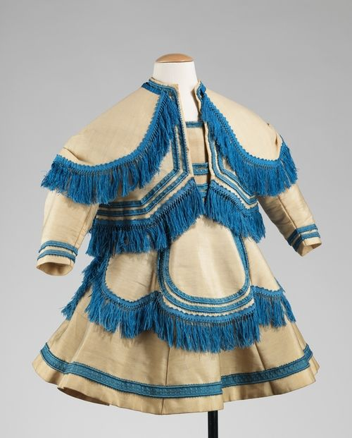 Little boy's white wool ensemble with turquoise blue trim, 1869.