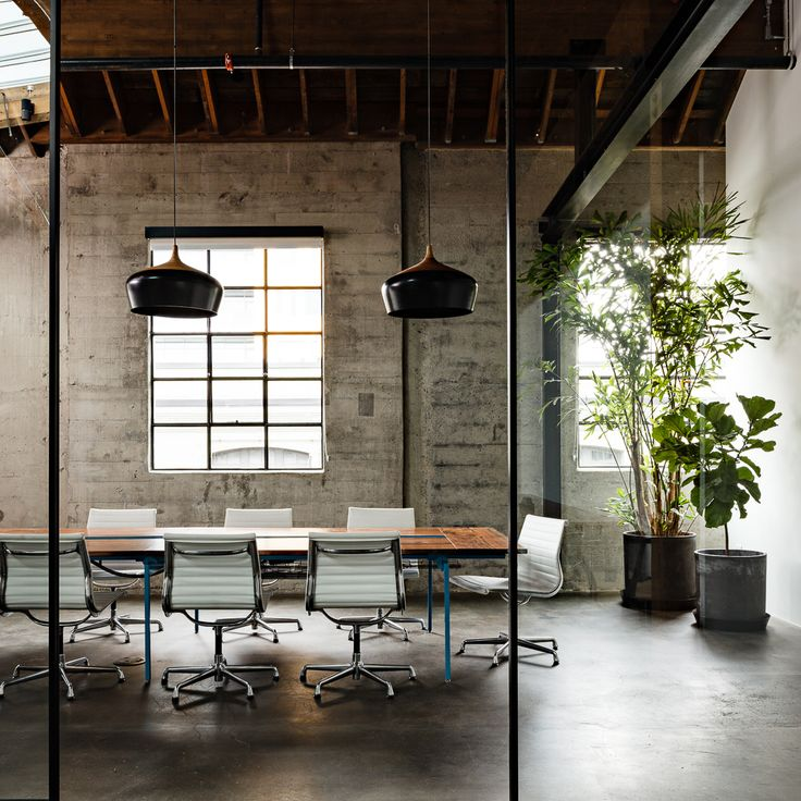 A beautiful office conference space design furnished with Eames Aluminum Group Chairs by Herman Miller.
