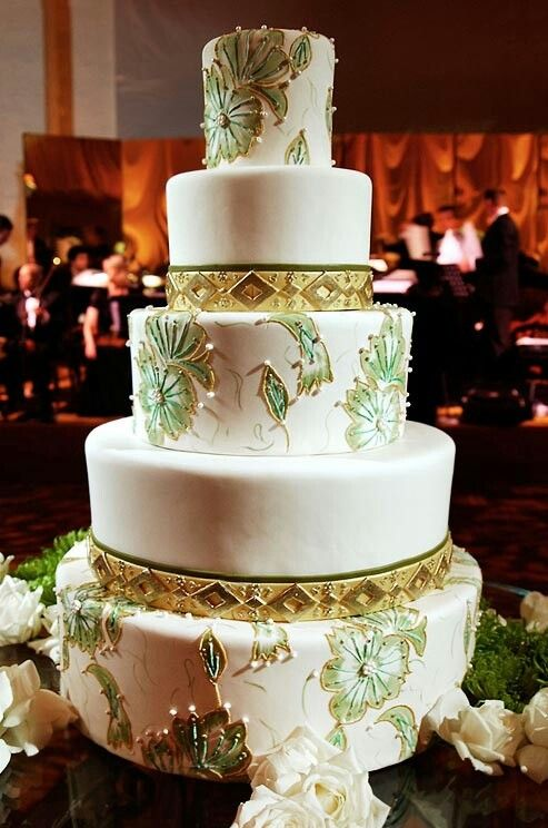 white multi-tiered painted with gold embellishments