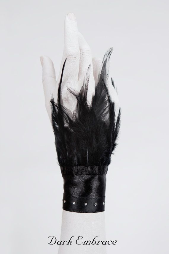 Black swan  feather wristcuff by DarkEmbraceHandmade on Etsy, €20.00