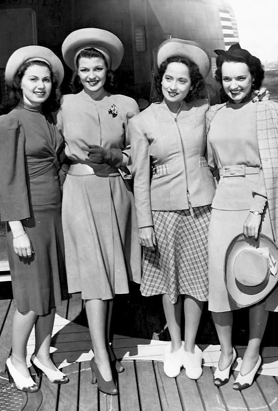 Rita Hayworth and Merle Orberon photographed with unknown starlets, circa 1941. fashion style photo print dress suit shoes hats 40s war era WWII