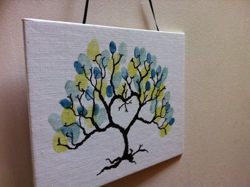 family tree! different colored thumbprints for each family member!