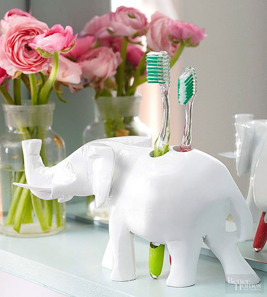 Create a statement with this quirky animal toothbrush holder made from a wooden figurine. To make the accessory functional, drill holes through it using a 3/4-inch drill bit, then paint it using glossy white spray paint. Look for inexpensive wooden animals or other objects large enough to accommodate holes without splitting at secondhand stores./
