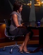 First Lady Michelle Obama Does a Metallic Shoe and Floral Brooch on Colbert, Is Awesome