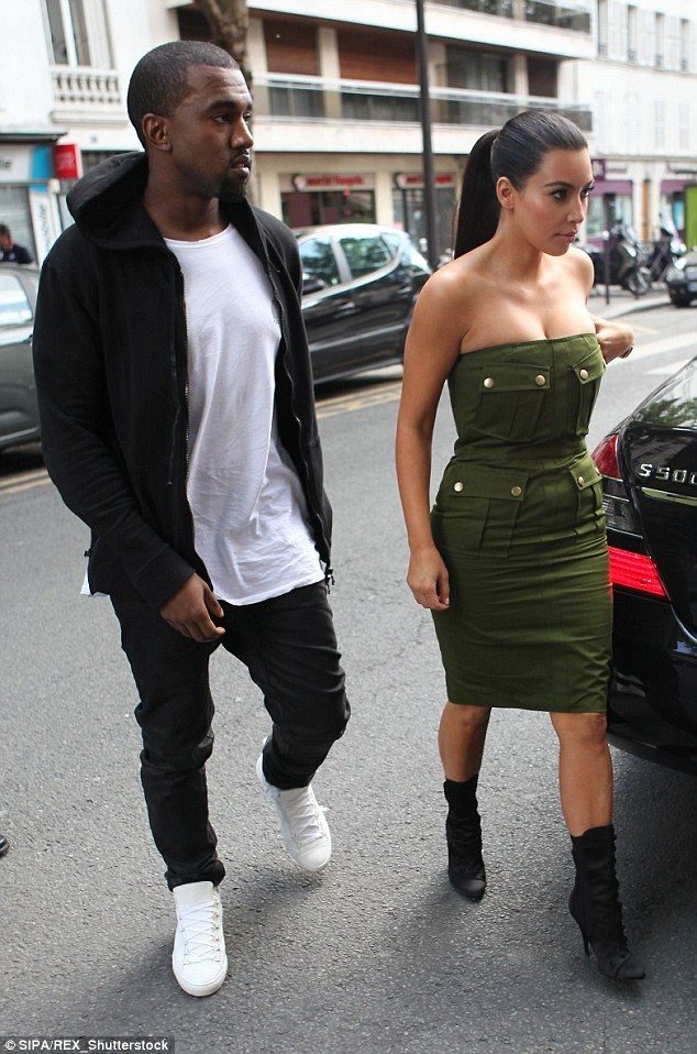 Who did it first? Kim wore a very similar style strapless dress in 2012 in a military-styl...