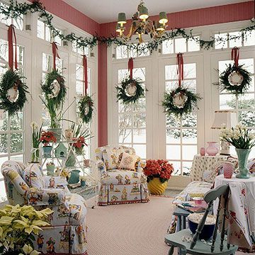 Red and Green Give a red room even more holiday style by hanging green wreaths on every window. These have the added embellishment of decorative plates hung inside each wreath circle. Wide red ribbon decorates each wreath and loops them up in varying heights.: