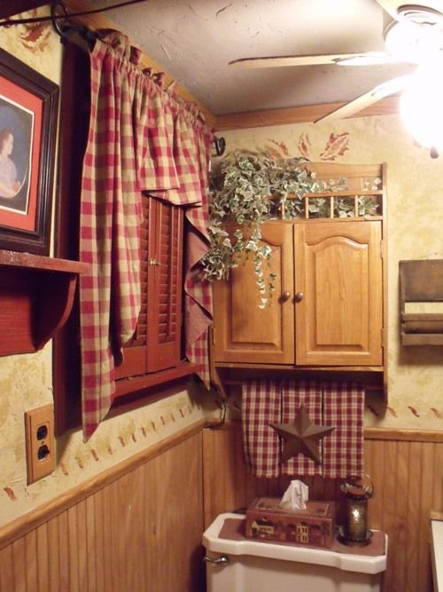 Primitive Bathroom Decor With Plaid Valance And Open Shelving And Medicine Cabinet With Plants And Towel Bar Country Primitive Bathroom Decor In Bathroom