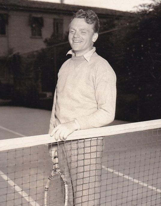 James Cagney pauses on the Warner lot tennis court in 1935