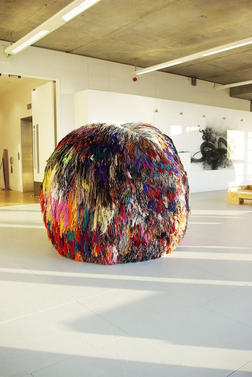 London-based artist Eleanor Davies is the creative force behind this magnificent, colossal pompom. Titled Over 200 Beautiful Colours, it is made from wool, newspaper, and rope and took two years to construct.