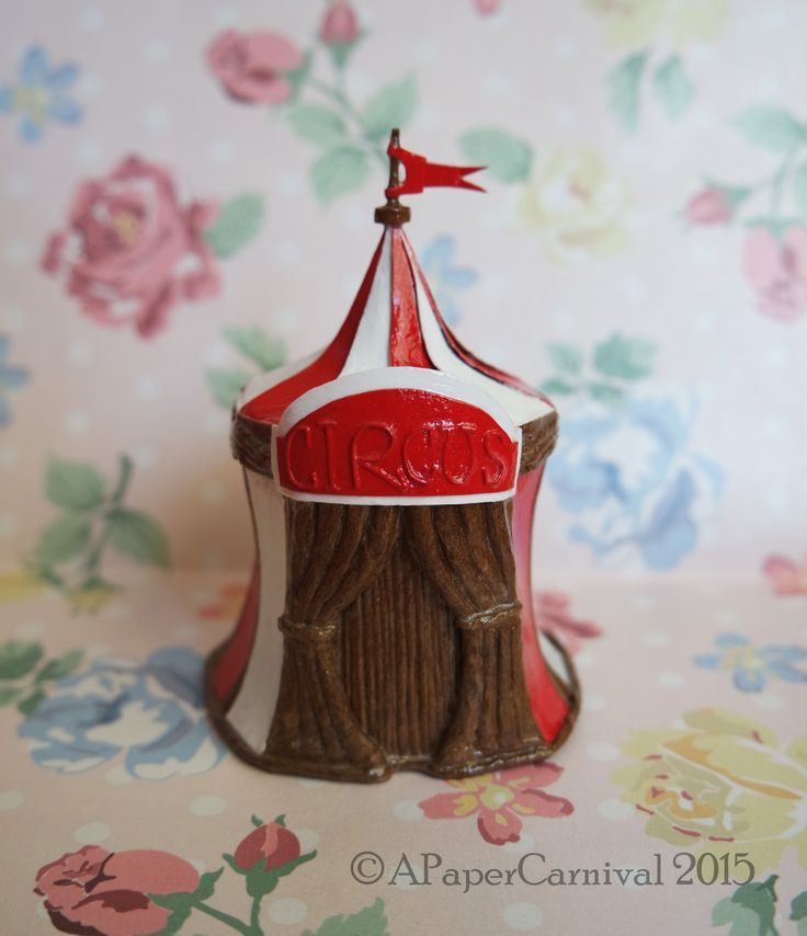 Handmade by Rachel Prout. A miniature circus tent constructed from cardstock, twine and raffia ribbon.