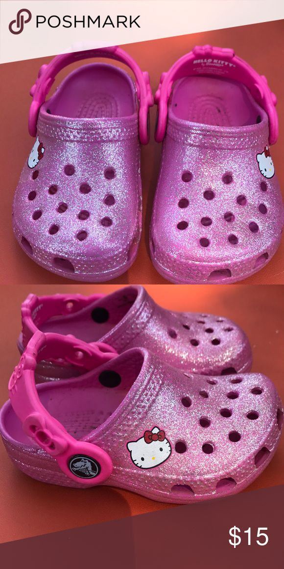 Toddler Crocs Gently used toddler girls crocs. Pink and sparkly with little Hello Kitty on the side. Does need to be wiped out. CROCS Shoes