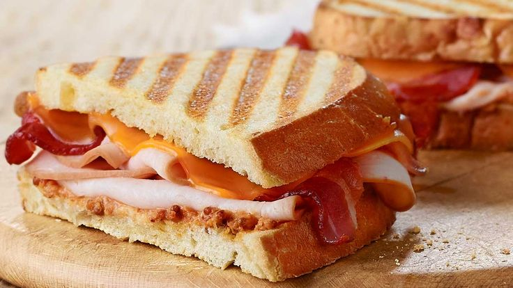 Copy Cat Recipe for Panera Smokehouse Turkey Panini - Smoked turkey breast, applewood-smoked bacon, smoked cheddar and sun-dried tomato ale mustard all grilled on freshly baked Three Cheese Bread.