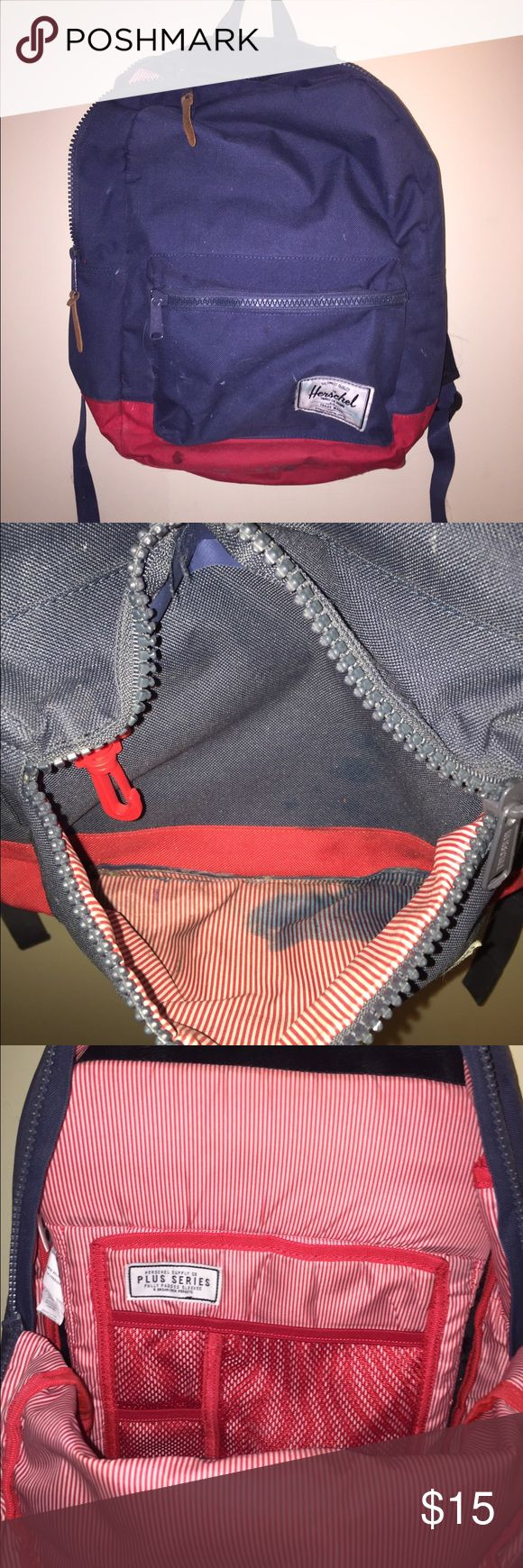 Herschel Bookbag Blue and Red, main pocket with fleece laptop and tablet sleeve, front pocket is stained on the inside from a blue leaked highlighter, obvious wear on the bottom Herschel Supply Company Bags Backpacks