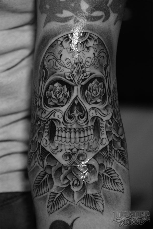 different look to a sugar skull tattoo...would be so sick in color with maybe a softer jaw line (for me personally)