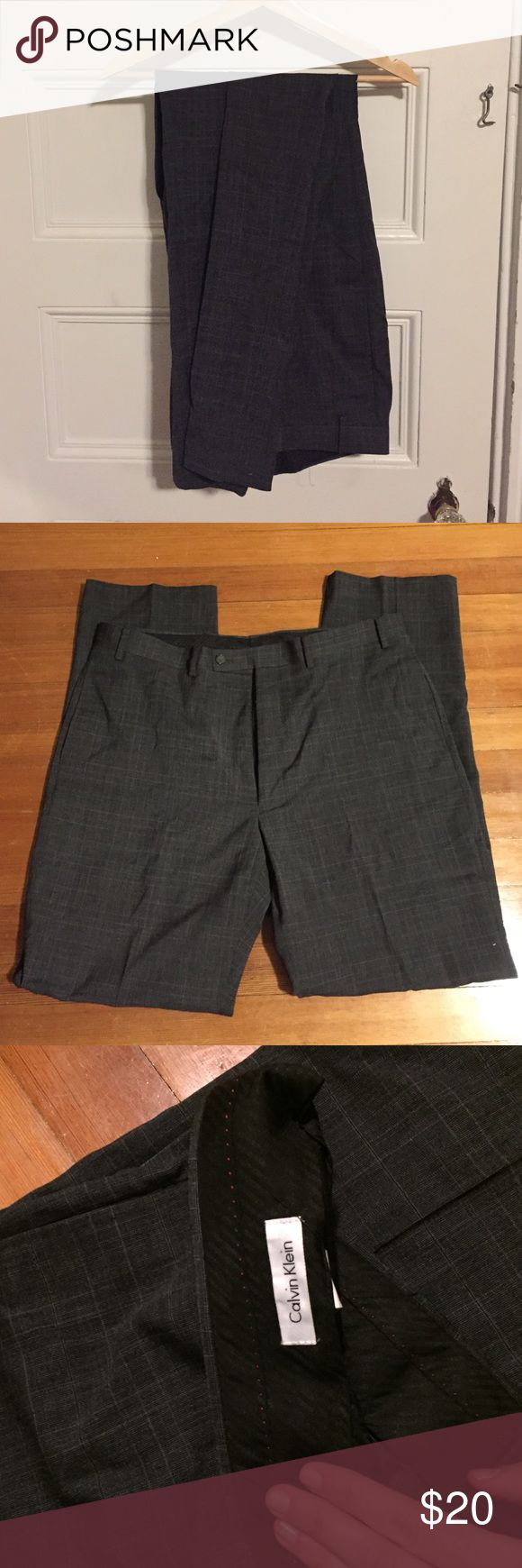 Men's grey dress pants Dark grey men's dress pants. Lovely sleek patterning. Great condition. Calvin Klein Pants Dress