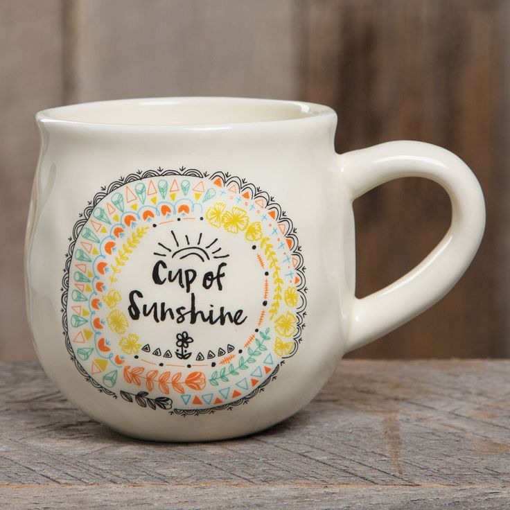 "Happy Mug with Cup of Sunshine - With a handcrafted feel and generous 16-ounce size, this ""happy"" ceramic mug features ""cup of sunshine"" saying and a heart printed on the inside bottom. Perfect for gifting. Dishwasher and microwave safe."