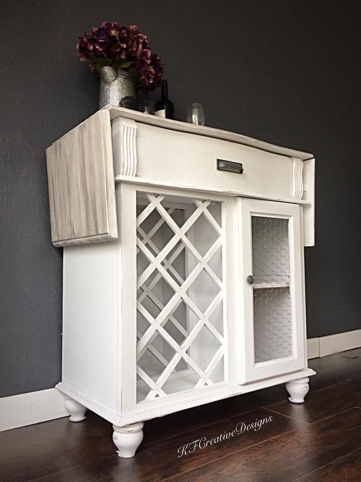 Farmhouse Style Wine Bar Cabinet In Antique White Chicken Wire And Faux Driftwood Finish On The Top Wine Bar Cabinet Bar Cabinet Cabinet