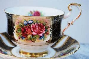 Paragon Tea Cup and Saucer Black and Gold with Roses