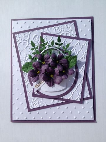 "By Blanerva Morten. Pansies from the Susan Tierney-Cockburn Pansy Die; basket from Memory Box ""Woven Basket"" die; leaves from Impression Obsession ""Leafy Branch"" die. Three white dry embossed panels from ""Fancy Fan"" folder, ""Lacey Brocade"" folder, and ""Polka Dot"" folder. Two purple panels and purple card base. Sentiment."