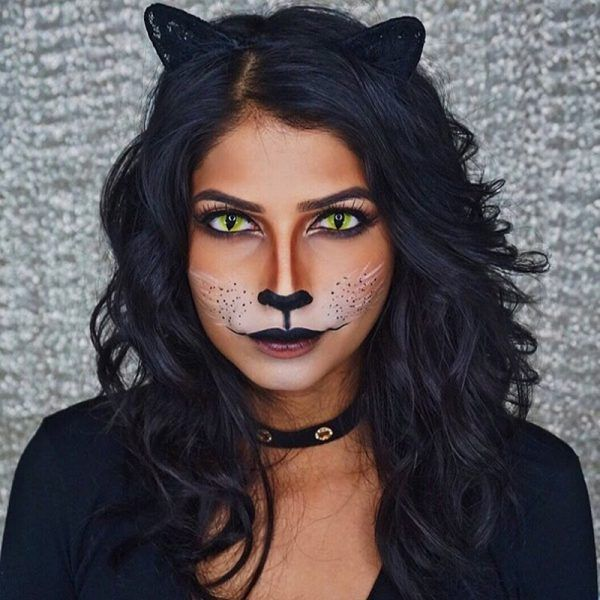 Panther - It may feel as though everyone dresses up as a cat for Halloween, but you can stick out from the crowd by opting to be a panther instead. Makeup artist Arshia made hers look more captivating with neon green contact lenses.