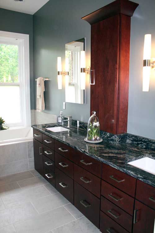 Classic Modern Master Bath - Town & Country, MO - Clean lines set the tone for this contemporary bath. The recessed tower built-in and cherry cabinetry make effective use of space, while frameless mirrors and chrome wall sconces add a chic touch.