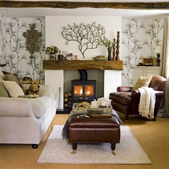 Warm browns and natural greens are a great decorating idea if you want to give your living room a rustic, natural feel. Statement wallpaper pulls the look together.