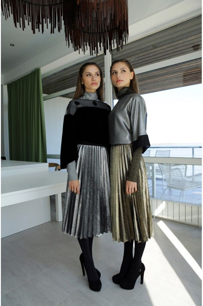 Metallic plissé skirt with a side zipper. Wear it with a sweater and sneakers by day - switching to heels for evening.