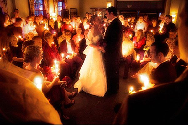 Reverse unity candle: Have an unlit candle passed out to each adult guest. To start the candle ceremony, the bride and groom light a single candle together. Then, they use that candle to light those of their bridesmaids and groomsmen, who then start spreading the flame to the rest of the guests.