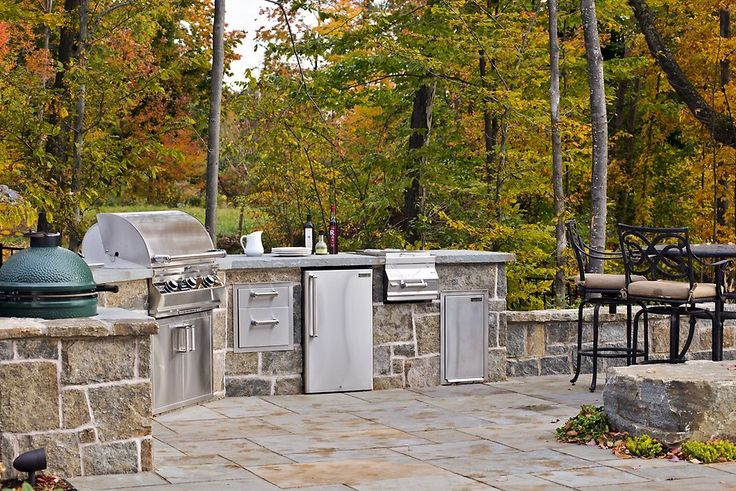 Outdoor kitchen design with durable flooring material