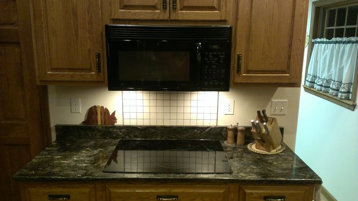 Saturnia Schist Kitchen Counter With Golden Oak Cabinets