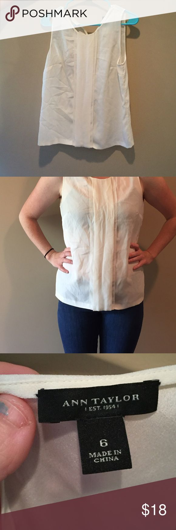 White Ann Taylor Tank White ann Taylor tank. On the dressier side, was used as a work shirt. Is slightly see through but worn with a cami underneath or a neutral bra and you can't tell. Ann Taylor Tops Tank Tops