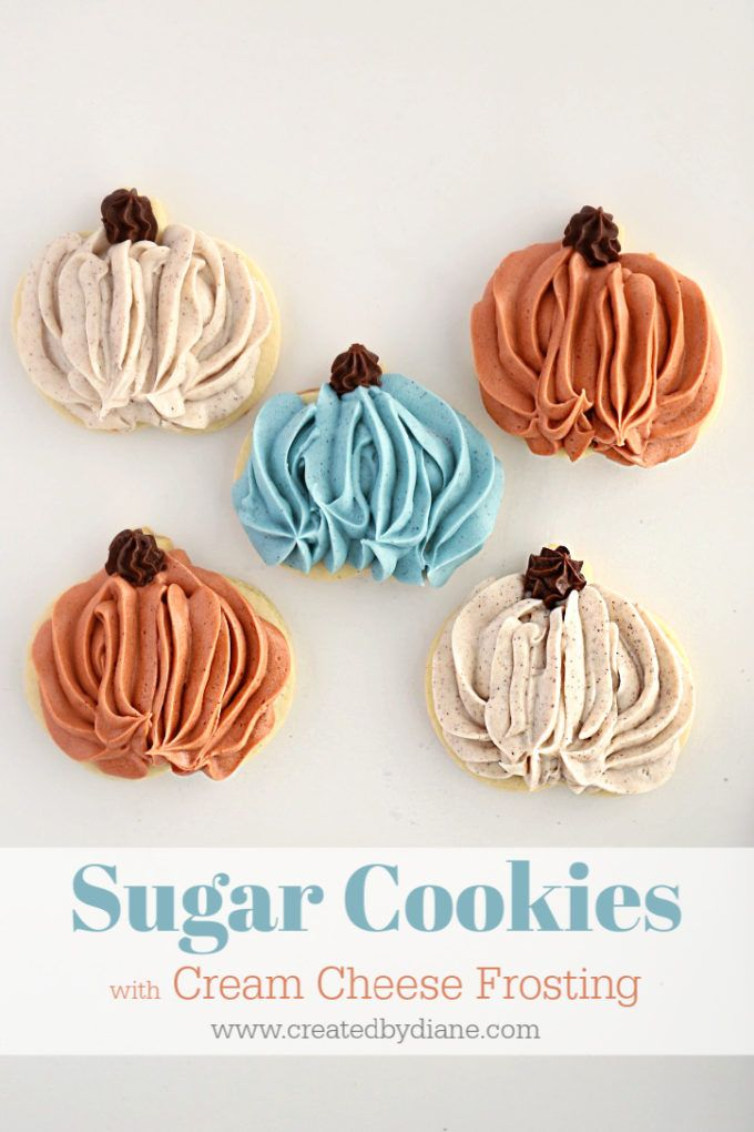 sugar cookies topped with cream cheese frosting to look like pumpkins, food colo…