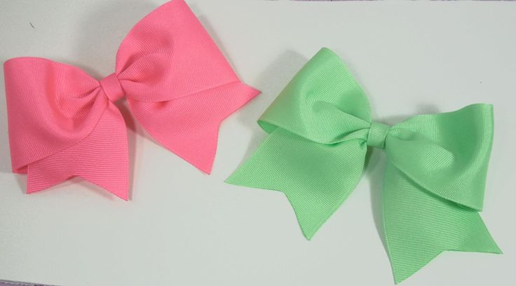 "In this tutorial you will learn how to make a Large Elegant Boutique Hair Bow. The supplies needed are: 2 1/4"" wide ribbon-- 20"" long Clip of your choice Wir..."