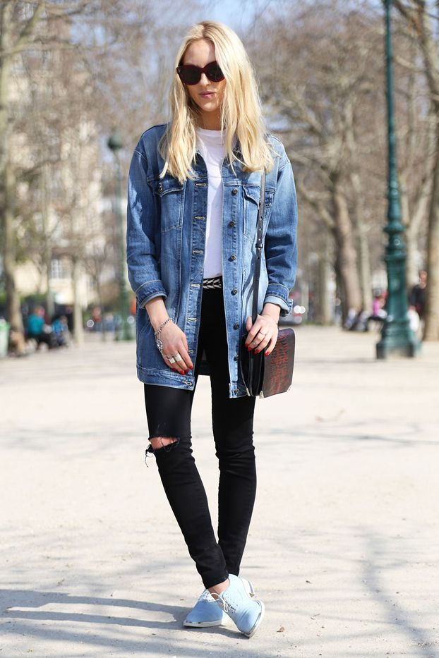 Blogger Peace Love Shea wears a white t-shirt, long denim jacket, distressed jeans, blue oxfords, and a crossbody bag