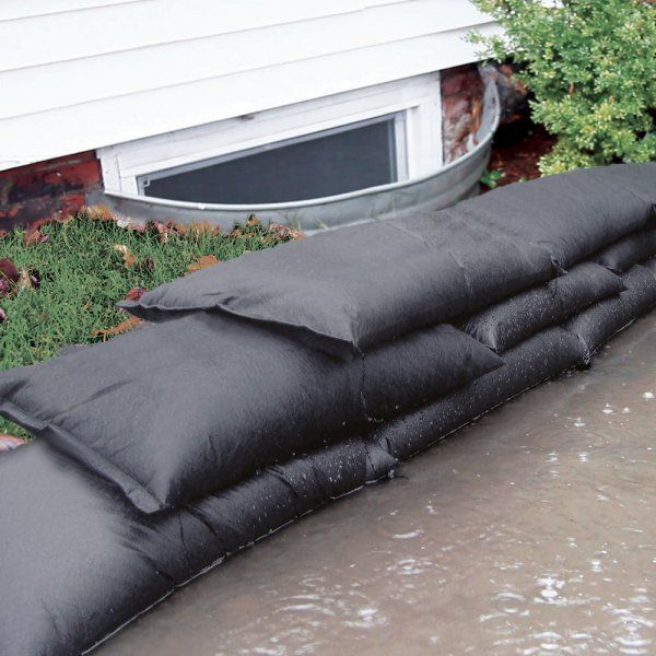 Sandless Sand Bags for flood prevention.  No Sand Required, activates with water, expands to full size in minutes, absorbs 4 gallons of water, starts out weighing less than 2lbs. #FloodPrevention