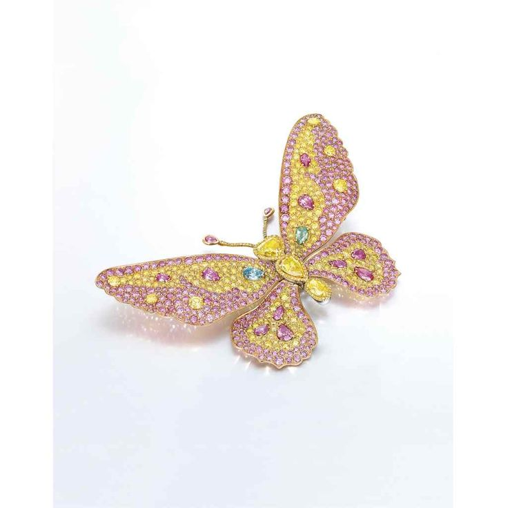AN EXCLUSIVE COLOURED DIAMOND BROOCH, BY CARVIN FRENCH $1,400,000!