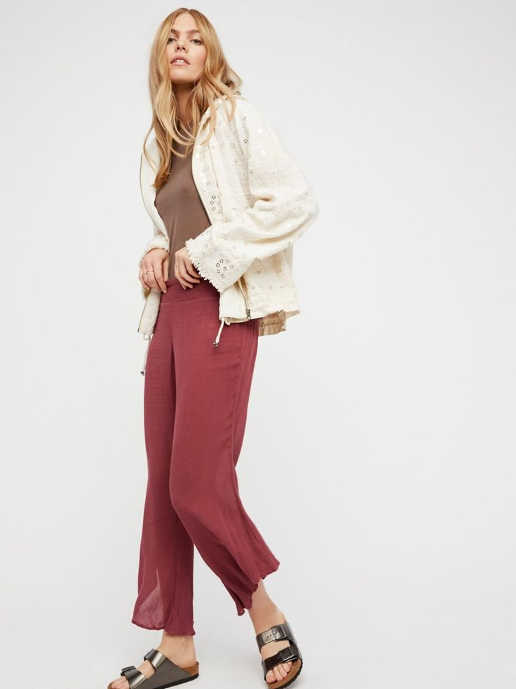 Dancing Days Solid Flare   Lightweight and crinkly pants in a relaxed fit with wide legs and an asymmetrical hem. Elastic smocked back waistband for an easy effortless fit.