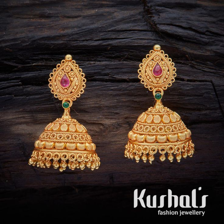 Pretty ornate South Indian Traditional Silver Temple Ruby Green Jhumka Earrings with Hanging Beads. this pair makes for great festive wear.