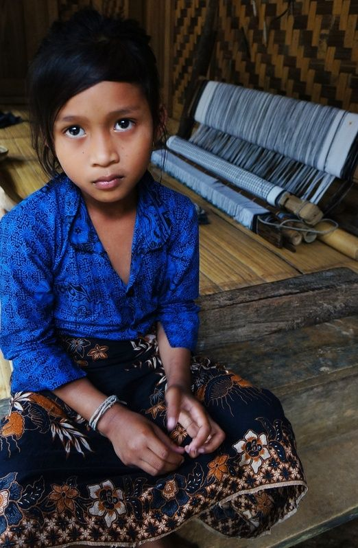 Baduy girl: Visiting the village is like taking a step back in time. The local Baduy people live traditionally without e...