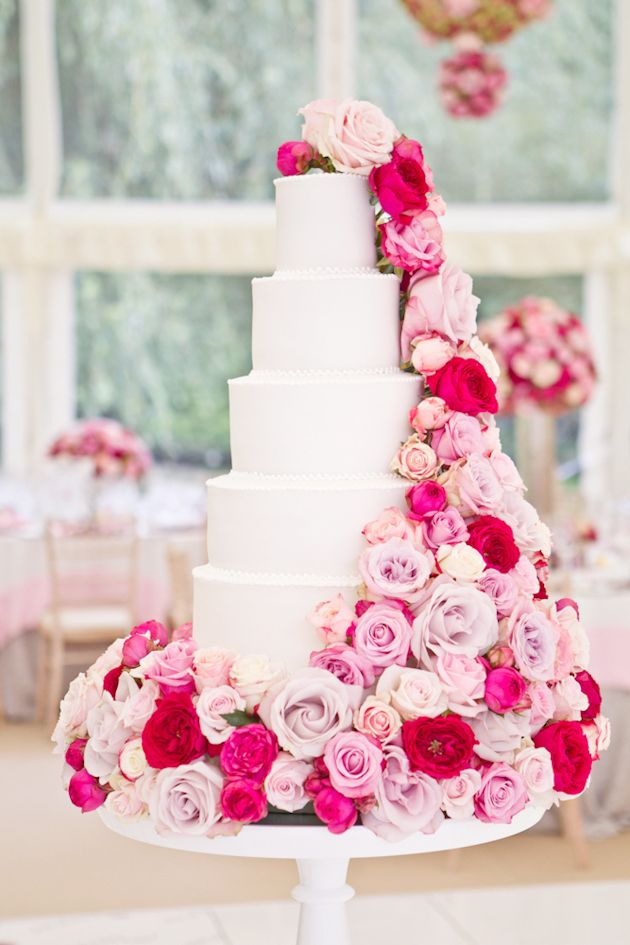 Incredible 5 tiered wedding cake with cascading roses  | Photography by Catherine Mead