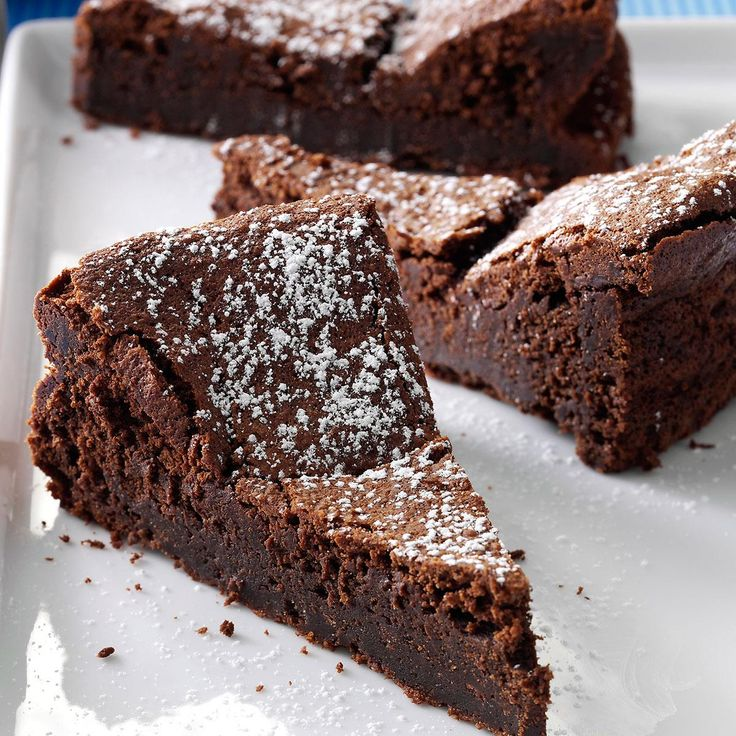 Flourless Chocolate Torte Recipe -Here's the perfect dessert for chocoholics—like me! I bake the melt-in-your-mouth torte all the time for special occasions. For an elegant finish, dust it with confectioners' sugar. —Kayla Albrecht, Freeport, Illinois