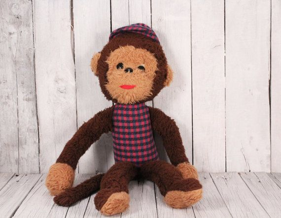 Monkey Plush Toy, Vintage Stuffed Monkey, Animal Toy Monkey with Cap, Monkey Circa 1970-70s, Brown Monkey, Bellhop Monkey, Vintage Chimp.  Cute plush monkey from the 70s. The monkey is brown in color with beige feet, hands and face. In good vintage condition.  Measure: 24 inches height (60 cm).  All photos are real. You get exactly what you see in the photos.  FAST SHIPPING!!! Possible express delivery with FedEx. I send each item recommended with tracking number. Thank you for visiting my…
