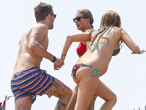 Who knew Ryan Reynolds had all that ink?! The actor put his leg tattoos on full display during a beach day in Westerly, Rhode Island over the July 4th weekend with wife Blake Lively and Taylor Swift.