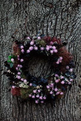 A stunning wreath decorates the tree at the Collingwood Children's Farm. The flowers for this wedding are just magical
