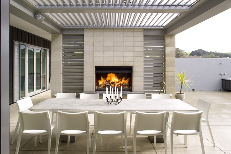 This looks like the perfect patio space. I've got an area similar to this in my backyard, but we don't have the fireplace or opening shutter roof! That roof would be my dream addition to our back porch--it would give just the right combination of sunlight and shade to keep it comfortable. The fireplace would make it my favorite spot of the whole house.